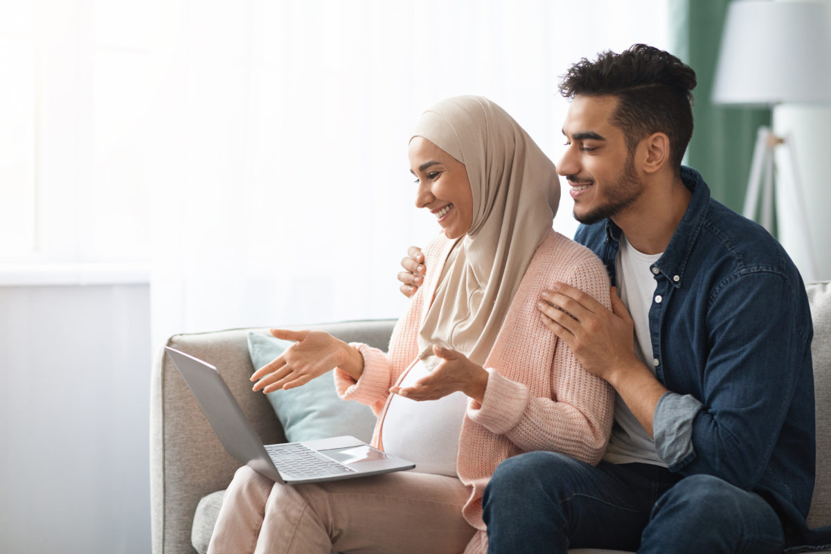 Pregnant Islamic woman and her husband attending a virtual baby shower